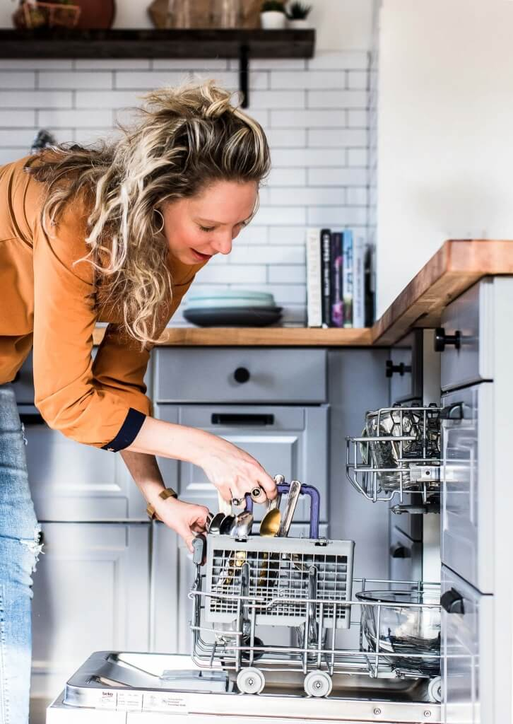 Woman Loading Dishes in Beko Dishwasher