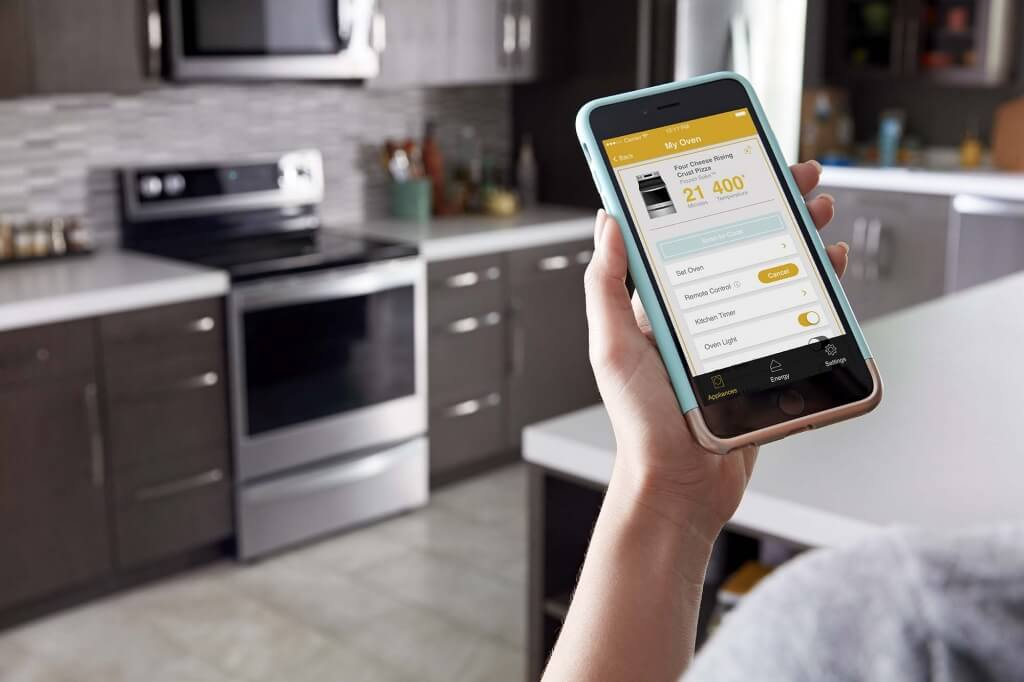 person using Whirlpool Scan-to-Cook app with connected oven