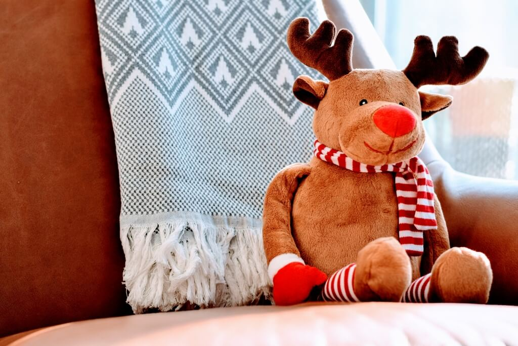 stuffed reindeer toy on chair