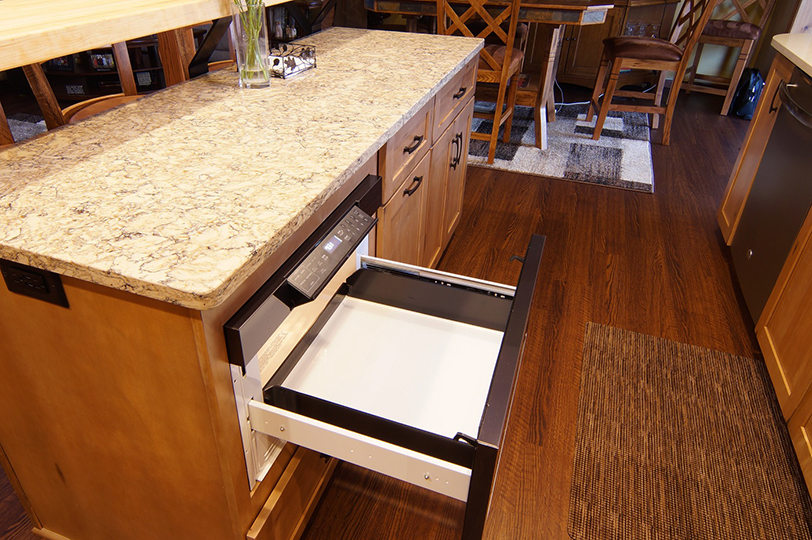 kitchen with pullout microwave drawer in island